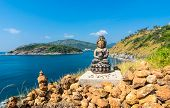 picture of budha  - Phromthep cape viewpoint with a budha statue over the blue sky Phuket,Thailand