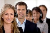 pic of telemarketing  - business customer support team in an office with headsets - JPG