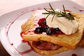 picture of french-toast  - Delicious french toast with bacon syrup berries and cream on a white plate on a wooden table - JPG