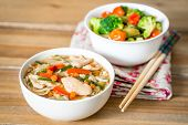 stock photo of noodles  - Bowls of Asian soup noodles and vegetables with Chopstick - JPG