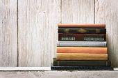 stock photo of spine  - old book shelf blank spines empty binding stack on wood texture background knowledge concept - JPG