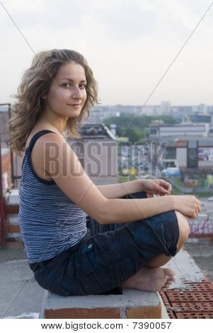 Young Woman On Roof