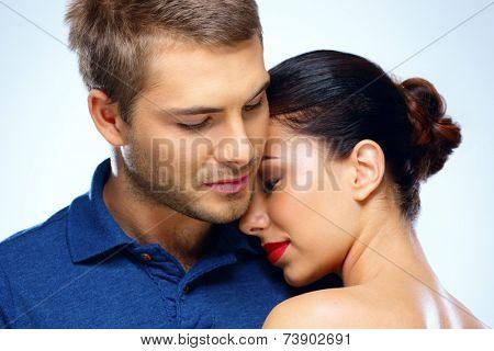 Portrait of a beautiful couple hugging