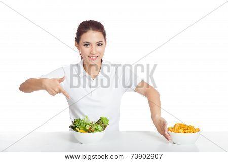 Asian Girl Smile Point To Salad Push Crisps Away