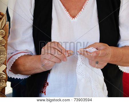 Woman Crochets Doily