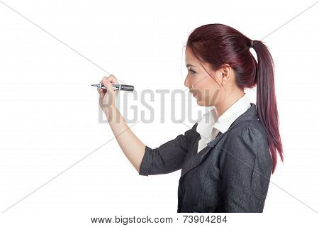 Side View Of Asian Office Girl Writing With A Pen On Air