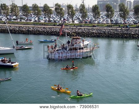 Mccovey Cove Fill With Kayaks, Boats, And People Having Fun, One Boat Featuring A Sign That Says 'it