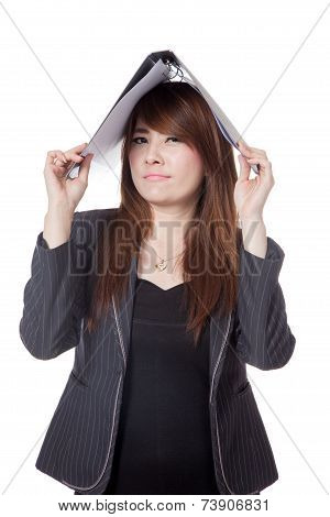 Asian Businesswoman  Put A Folder Over Her Head