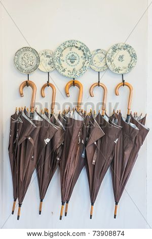 Umbrellas Hanging Against The Wall