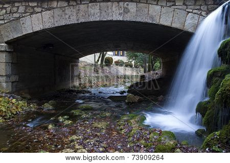 Bridge with waterfall