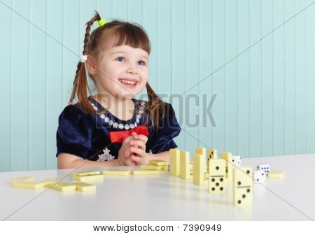 Happy Child Playing With Toys