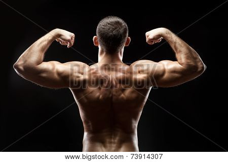 Man Back Shows Big Muscles.