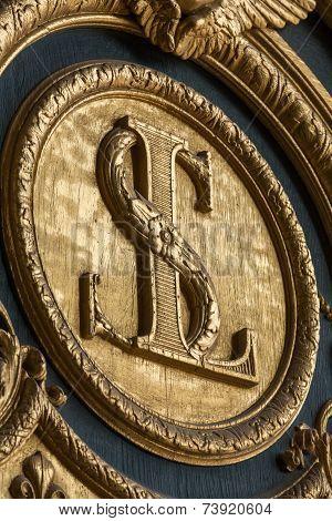 Heraldic motifs on front door to Les Invalides. Paris France