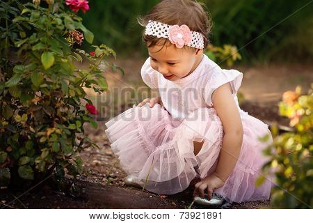 Little Girl Enjoying Flowers