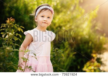 Beautiful Toddler In Garden