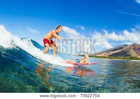 Father and Son Surfing Together. Riding Wave on Surfboard Tandem. Fatherhood, Family Fun Outdoor Lifestyle.