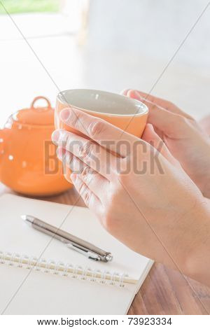 Hand Hold Hot Tea Cup