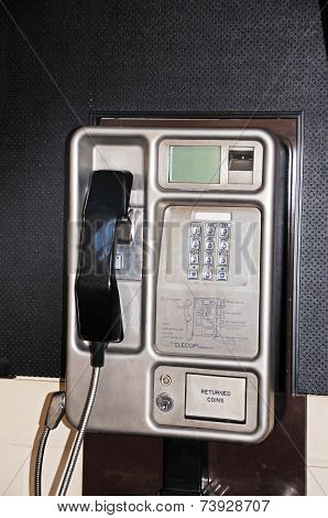 Public coin operated telephone.
