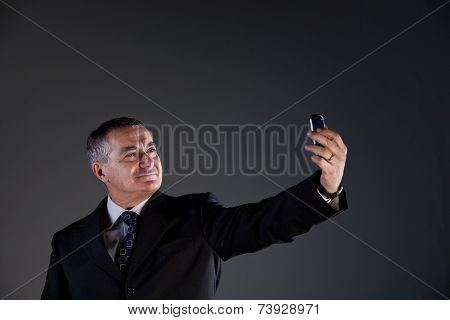 Manager Taking Himself A Selfie With His Mobile