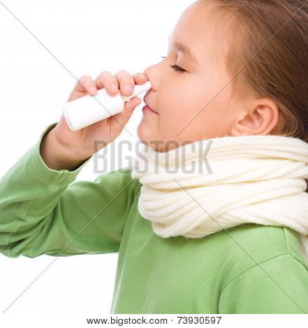 Cute Girl Spraying Her Nose