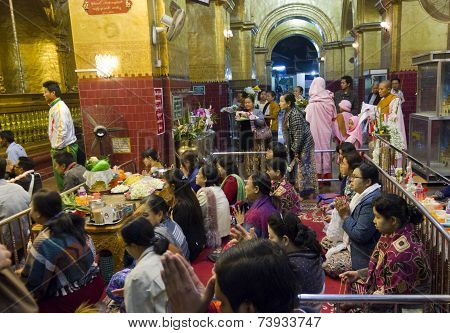 People Praying in a temple