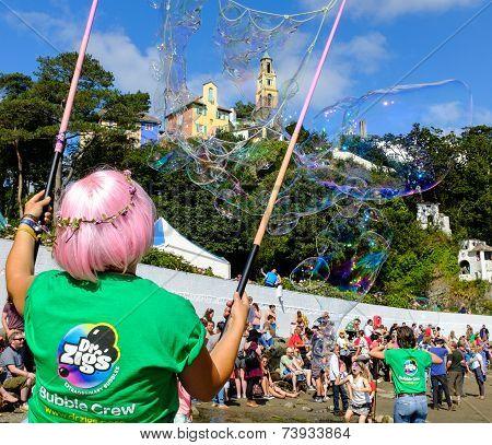 Making bubbles, beach, Portmeirion