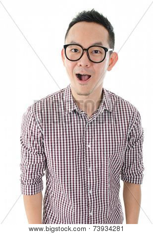 Portrait of Asian man looking at camera, shocked and standing isolated on white background.