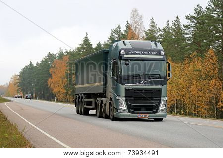 Green Volvo FH Semi Truck On The Road In Autumn