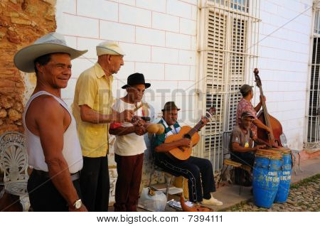 Group Of Traditional Musicians Playing In Trinidad Street, Cuba. Oct 2008