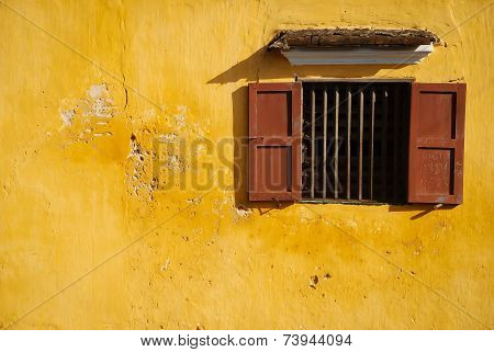 opened-window on yellow wall