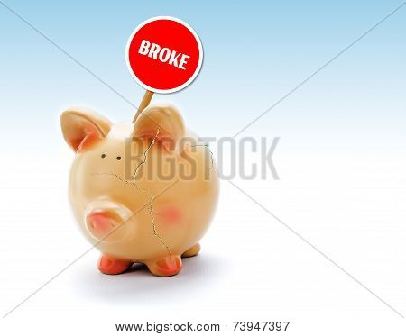 Broken Piggy Bank With Cracks And