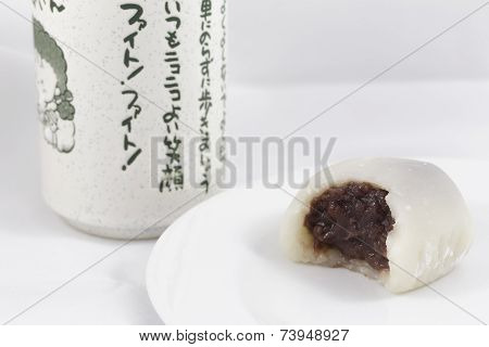 Bitten White Mochi and Japanese Tea Cup