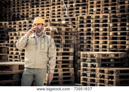 Warehouse worker having a break with coffee