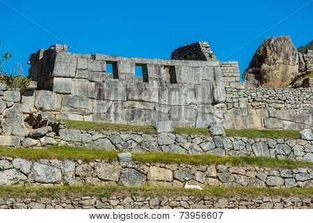Three Windows Temple in Machu Picchu, Incas ruins in the peruvian Andes at Cuzco Peru