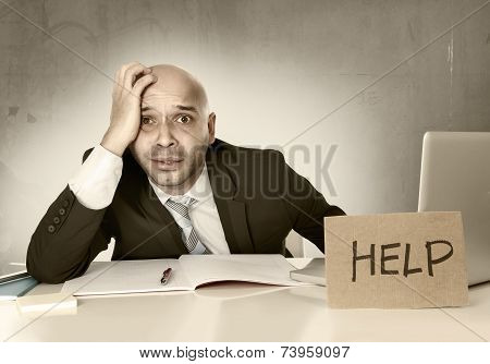 Overworked Unhappy Bald Hispanic Businessman In Stress With Computer