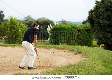 Man at recreation playing golf on green course