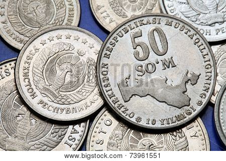 Coins of Uzbekistan. State emblem of Uzbekistan and a map of Uzbekistan depicted in the Uzbekistani som coins.