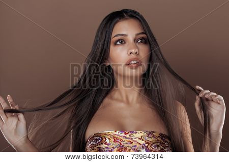 cute happy young indian woman in studio close up smiling