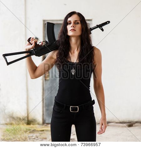 War, conflict. Female soldier with a gun