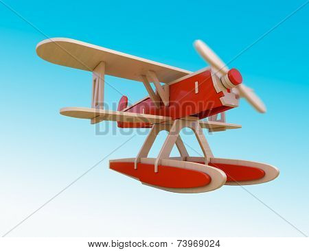 Toy wooden airplane flying in the sky