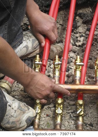 Pipefitter Attaches Plastic Pipe