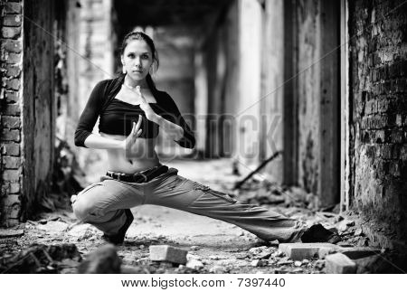 Young Woman In A Ruined Building