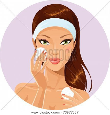 Girl cleaning her face with cotton pad