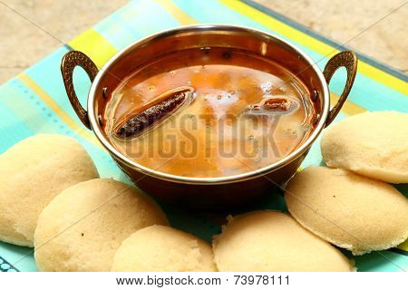 Idly with sambar Iddli is a traditional breakfast of South Indian households