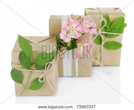Natural style handcrafted gift boxes with fresh flowers and rustic twine, isolated on white
