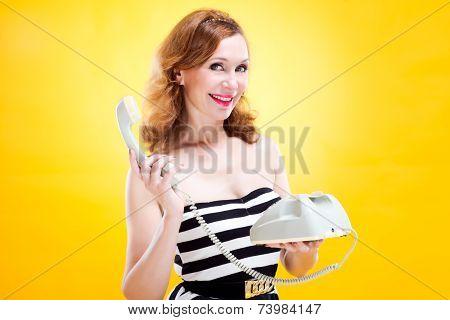 Pinup girl flirting on phone