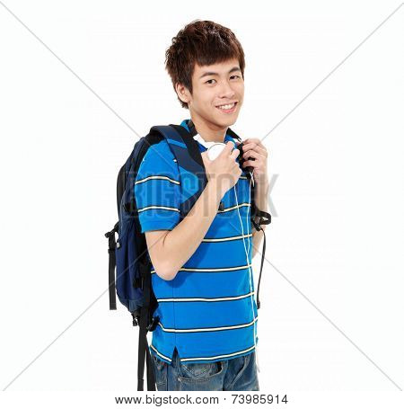 young man standing man with backpack with headphones posing