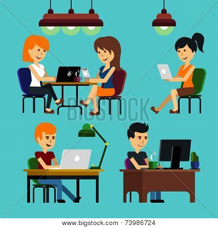 People sitting on chair at table in front of computer monitor
