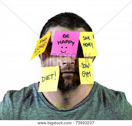 Overworked Man In Stress With Face Full Of Post It Notes Covering Him With Reminders And Resolutions