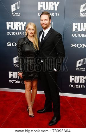 WASHINGTON, DC-OCT 15: Actor Jim Parrack (R) and Leven Rambin attend the world premiere of